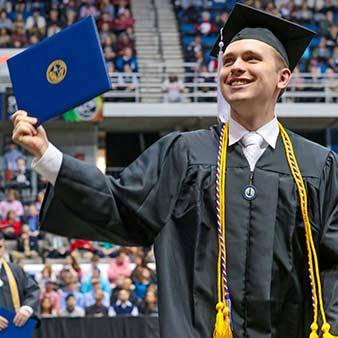 New graduate at commencement